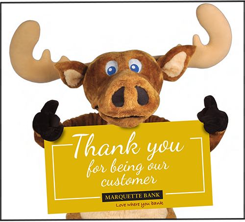 Marquette Bank official mascot, Marty the Moose holding a gold sign that says, Thank you for being our customer