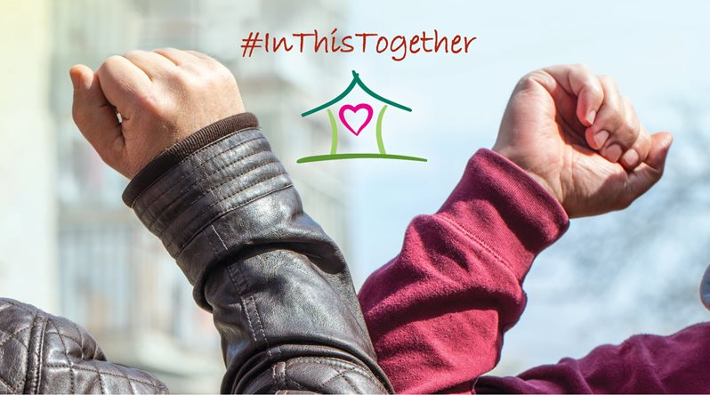 "Image of two individuals elbowing each other in a ""high five"" type of action. #InThisTogether words on the top of the image."